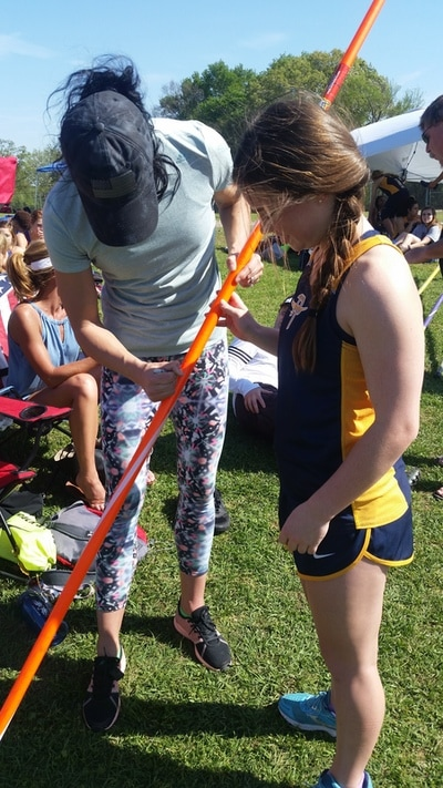 Jenn Suhr autographing Chelsea Chadwick's pole
